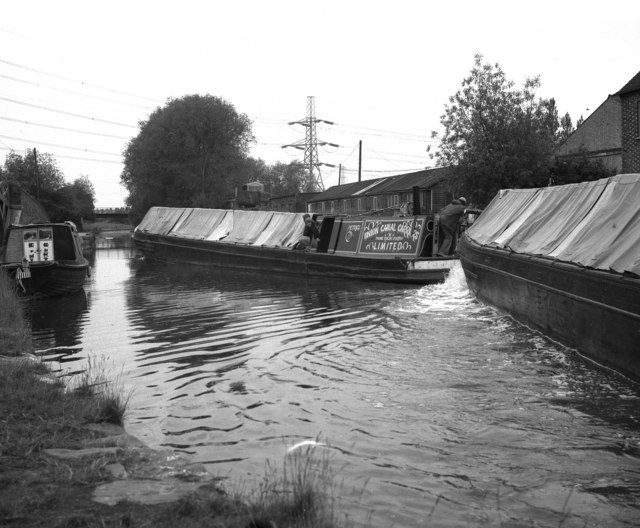 The canal river being utilised by boats since the early days of it being built. Captured in black and white.