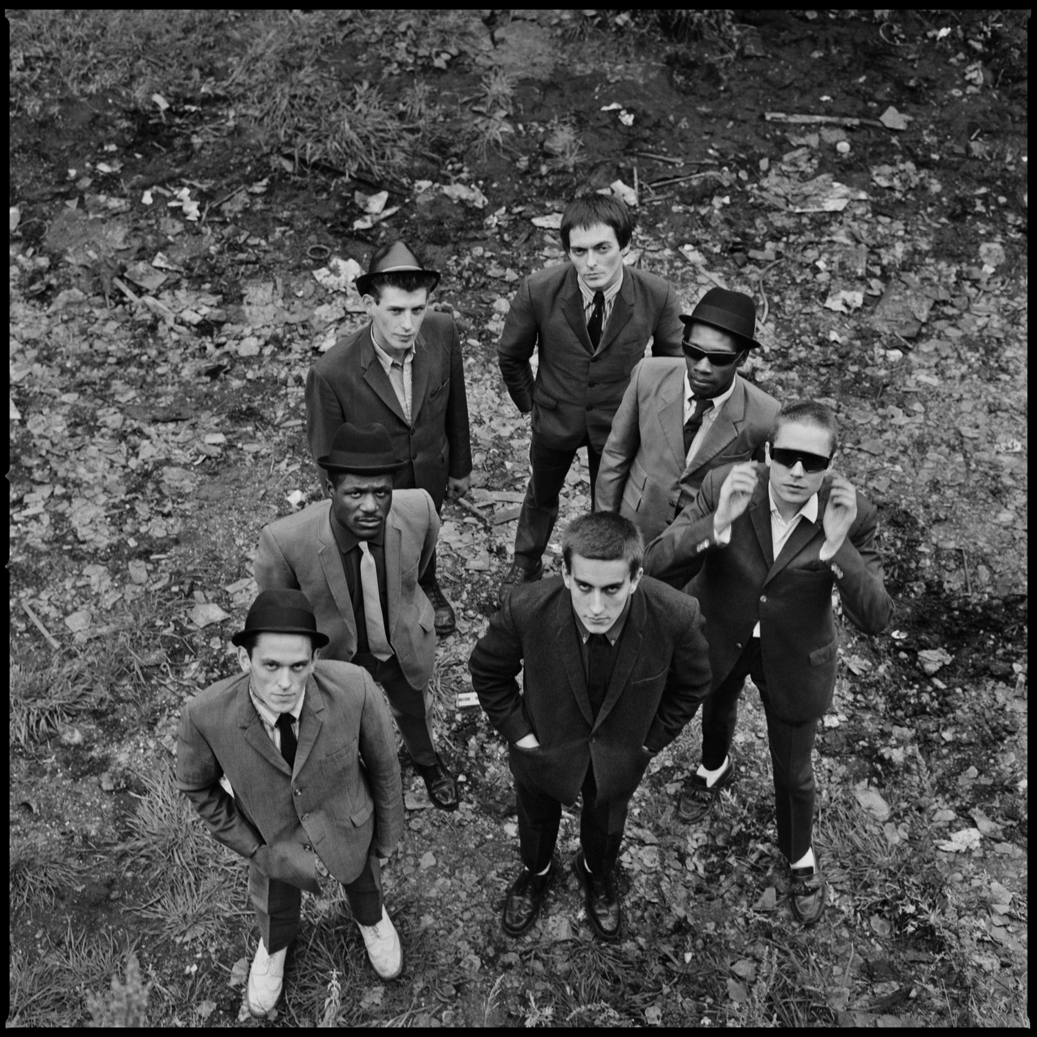 The Specials LP cover - members of the band standing in the basin looking up towards the camera. Photographed by Chalkie Davies in black and white.
